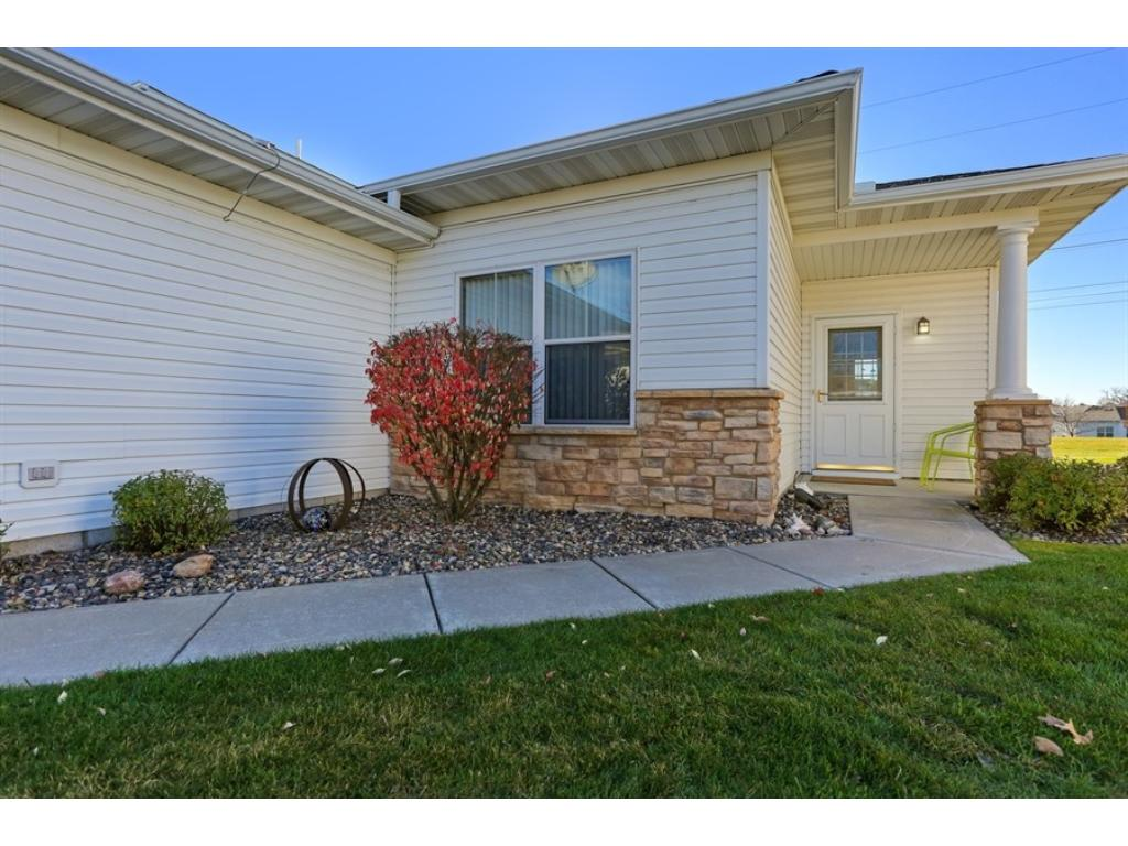 Beautiful curb appeal - gutters, maintenance free, concrete walkway and insulated garage!