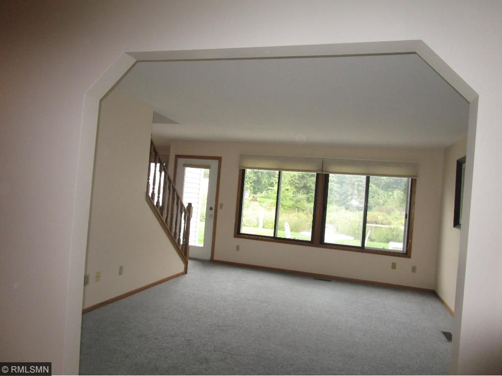 View from formal entry to the sunny living room that overlooks patio & pond!