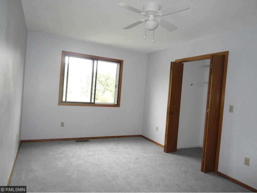 Large bedroom has walk in closet & great pond view