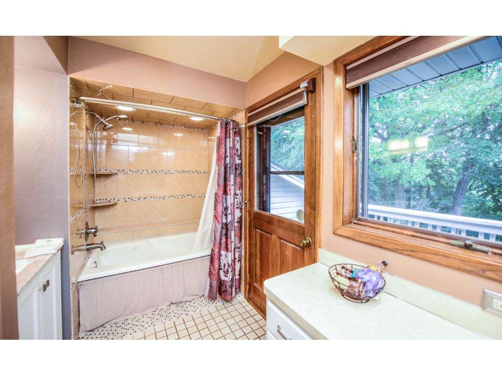 Master bath with dual vanities, and tub shower combinations.