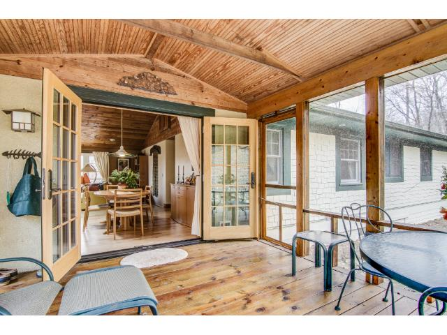 The screened porch extends the home's living spaces creating a delightful additional room to enjoy the three warmer seasons.