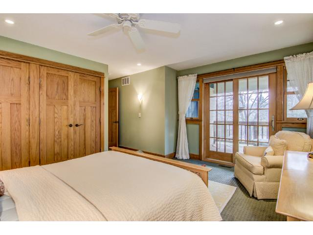 Suite has two closets, each with attractive double doors.  French doors to the balcony deck.