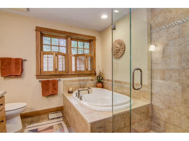 Gorgeous finishes in luxurious bathroom with soaking tub and separate shower.