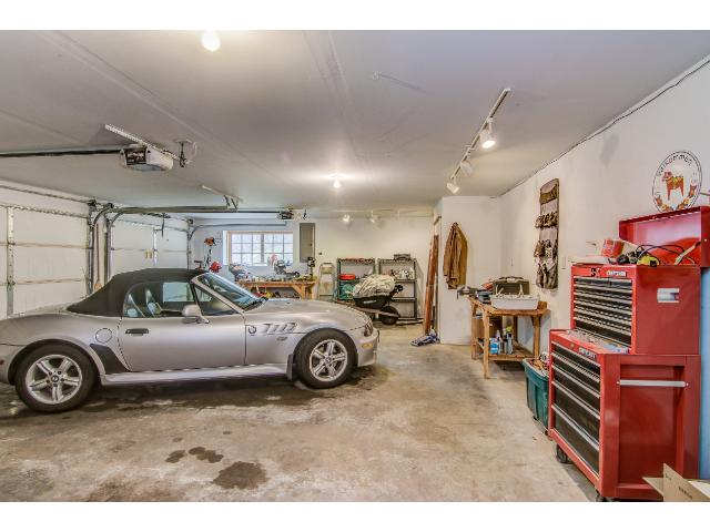 The 3 heated garage stalls and the additional garage make this the perfect home for people who need workshop space or for the collector/hobbyist.
