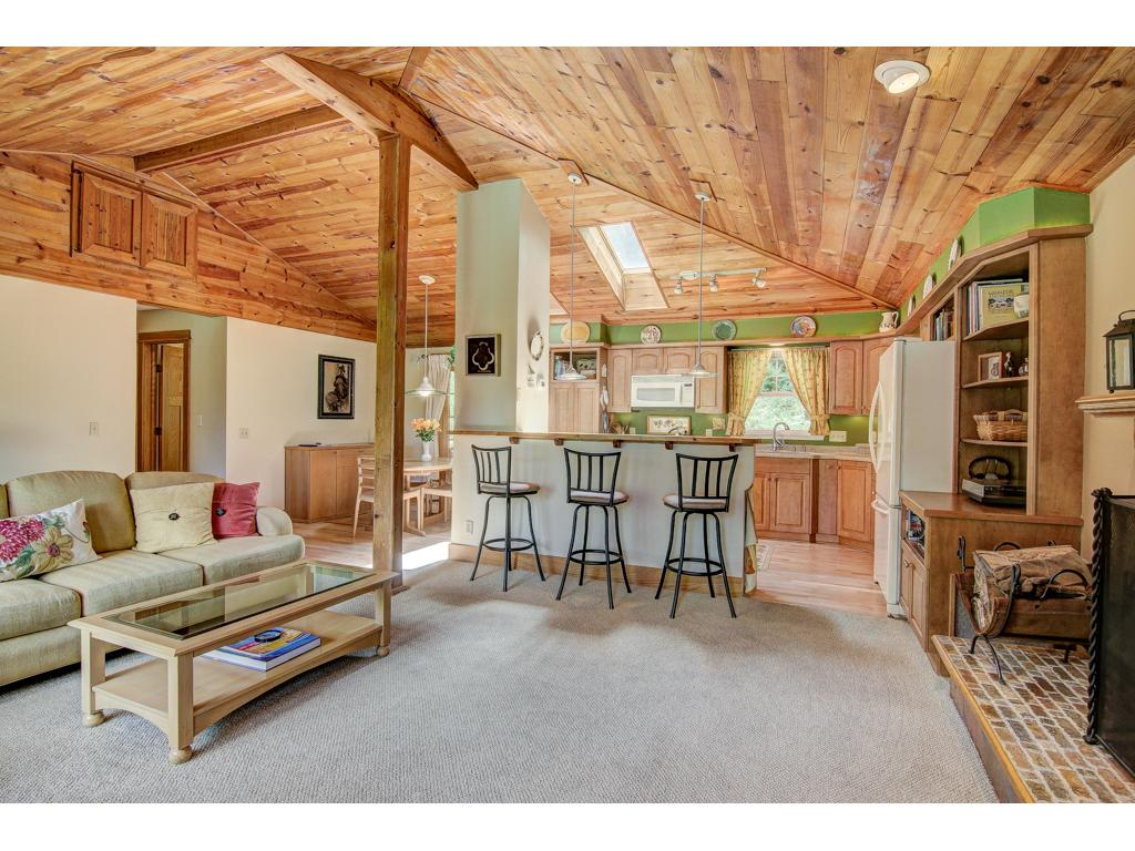 Built in 1959, the house was expanded and upgraded in 2005 with architecturally designed addition.  The new kitchen includes Corian counter tops. Kitchen is open to the beautiful ambiance of the vaulted ceiling great room.