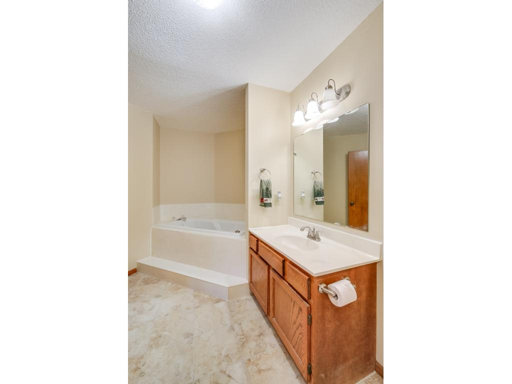 Upper level bathroom with a walk-in shower and a large jacuzzi tub!