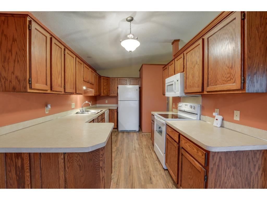Spacious kitchen with ample storage space & counter space! Enjoy preparing all your favorite meals!