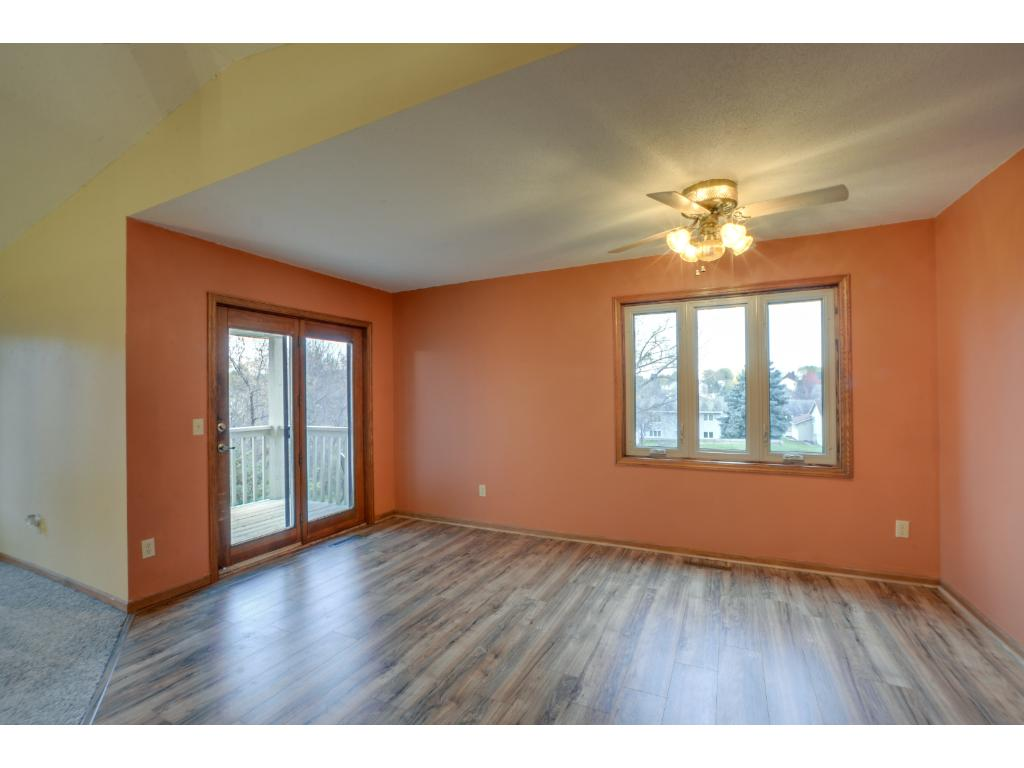 Spacious dining room w/ great natural light & walk-out access to the deck!
