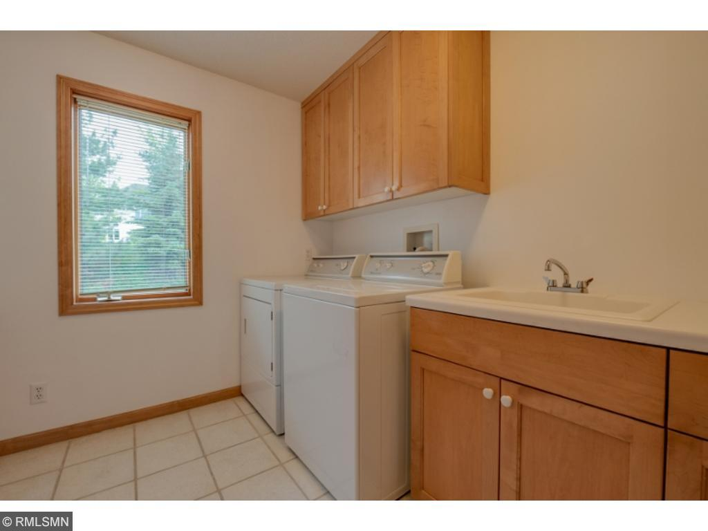 The garage entry is a level of its own featuring this spacious laundry room with great storage. You'll also be pleased to find the guest powder room, coat closets and space for extra storage.