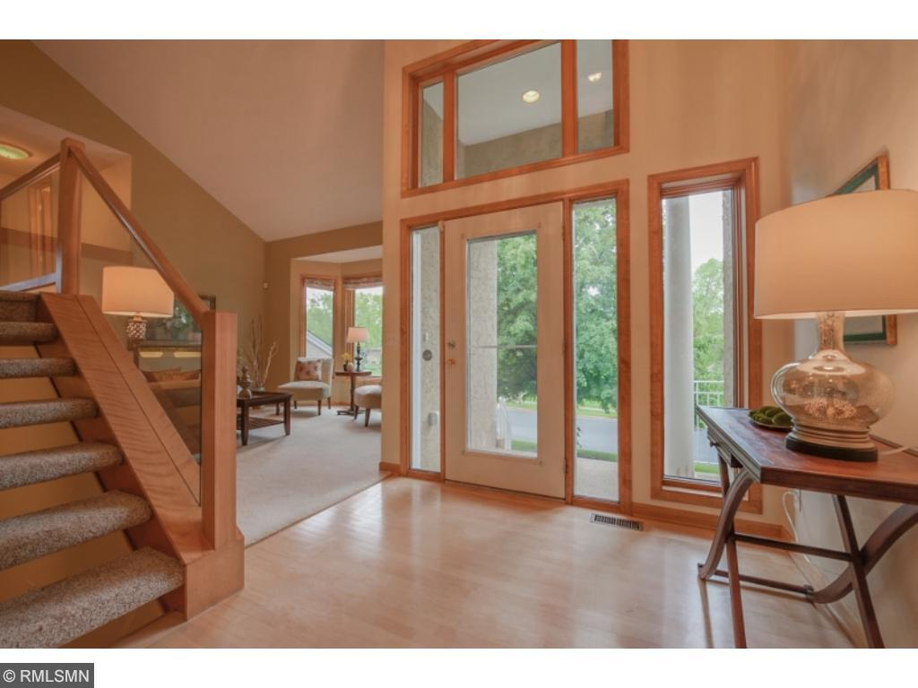 Aggregate front steps lead to an impressive main foyer filled with natural light and rich maple flooring.  Impressive ceiling lines, open staircase with glass and an abundance of custom windows.