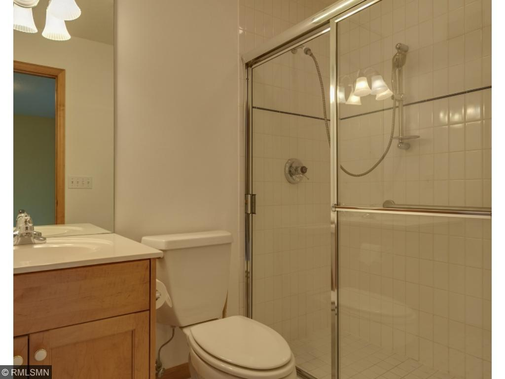 En suite bath for the previous bedroom that includes glass shower doors.