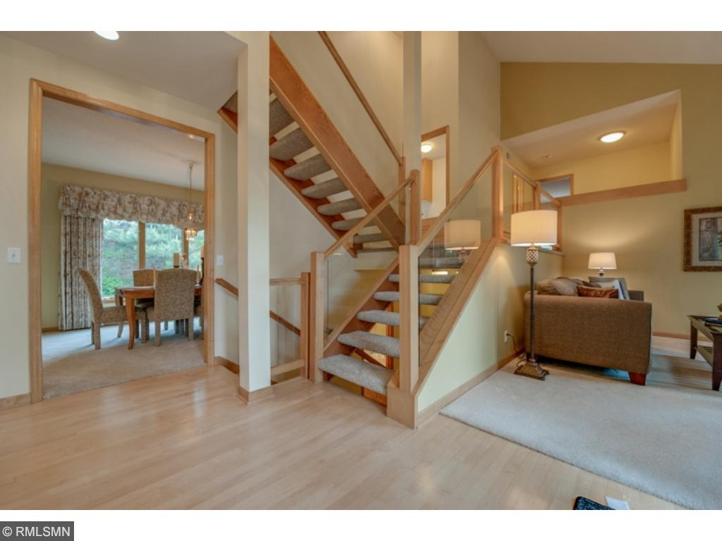 A great loft area located at the top of the first landing overlooks the main level and foyer.  Stairs have open risers and plexi-glass between newel posts. Stair carpet is new!!