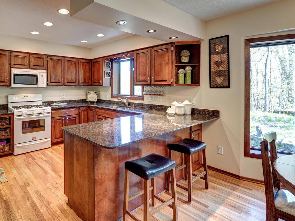 Beautifully updated kitchen, granite counters, and hardwood floors.  Great space to cook and entertain!