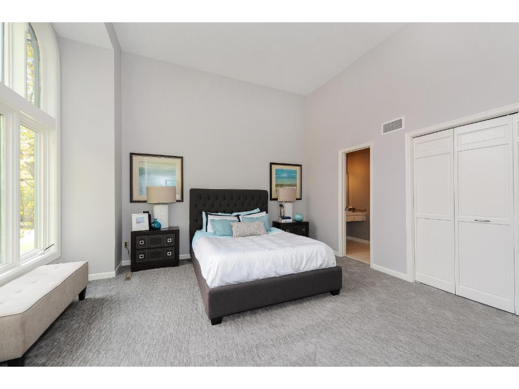 Large Master Suite Features Vaulted Ceiling, Walk-in Closet and Private Bath