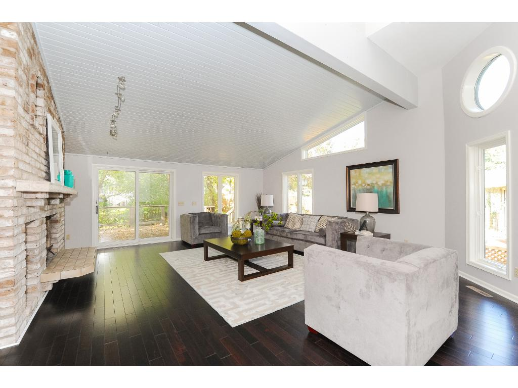 Living Room Features New Hardwood Floor, Vaulted Ceiling and Many Windows