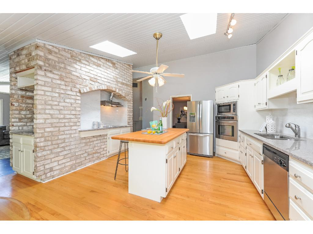 Another View of the Kitchen Featuring Hardwood Floors and Center Island