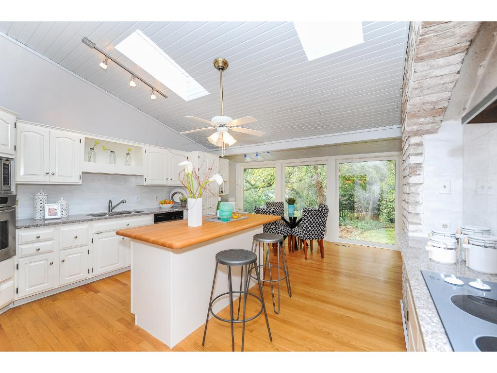 Kitchen Features Informal Dining with Views to the Backyard Through Large Windows