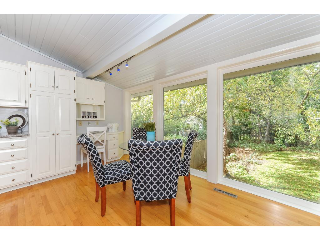 Informal Dining In Kitchen Features a Door to the Large Deck