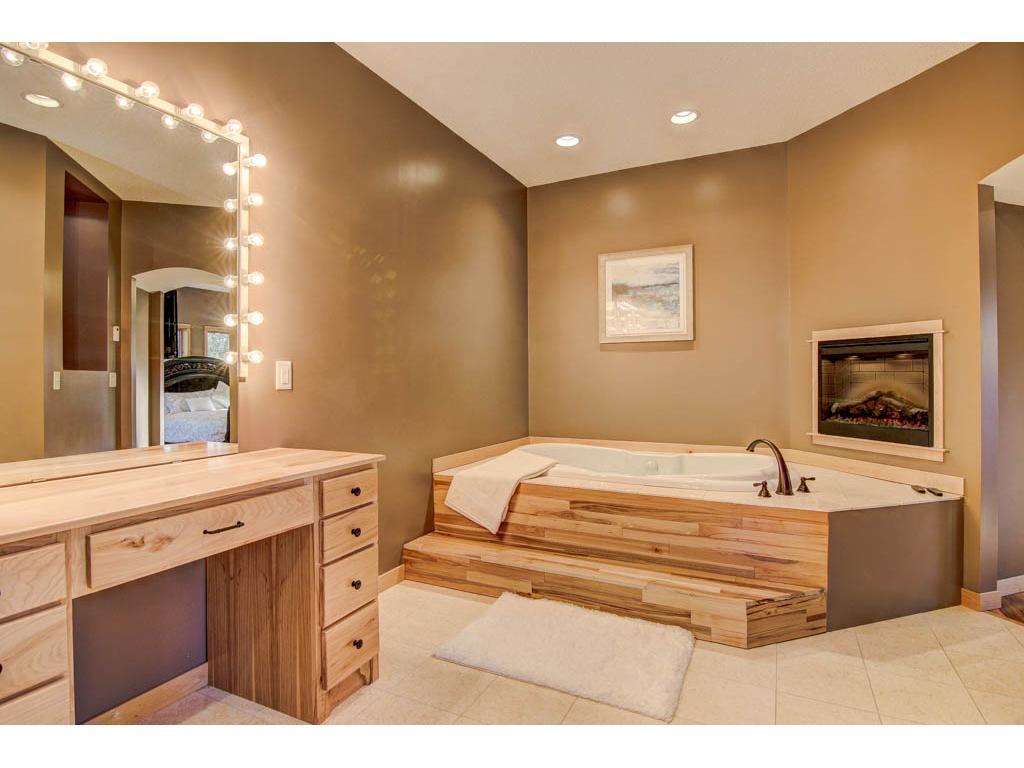 Enjoy the spa-like master bathroom with a whirlpool bath, fireplace and vanity.