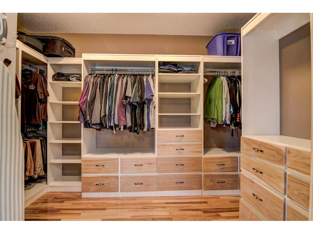 This walk-in closet has  lots of storage space for all the extras.