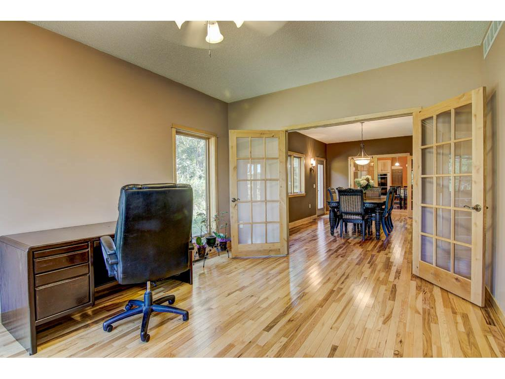 This is one of two rooms that could be an office or multi purpose room with windows for lots of nature light.
