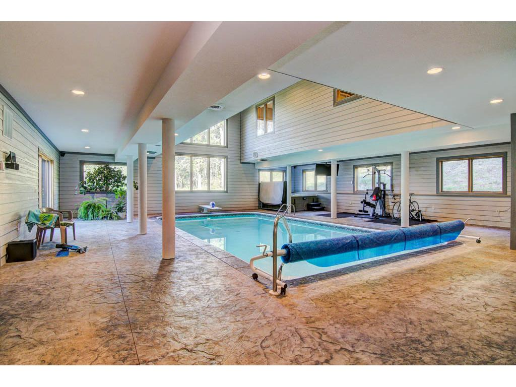 The pool room has A/V cabling,pivoting TV bracket for viewing while working out, swimming or in the hot tub. Also includes LED lighting and surround speakers.