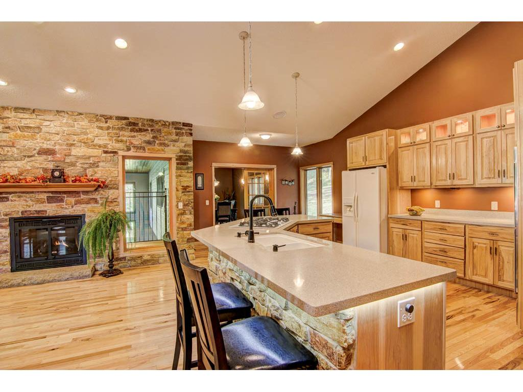 Beautiful kitchen with hickory cabinetry and quartz counter tops. Finished stonework around the center island. Great for entertaining!