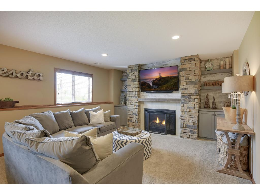 Finished basement with lookout windows and gas fireplace.
