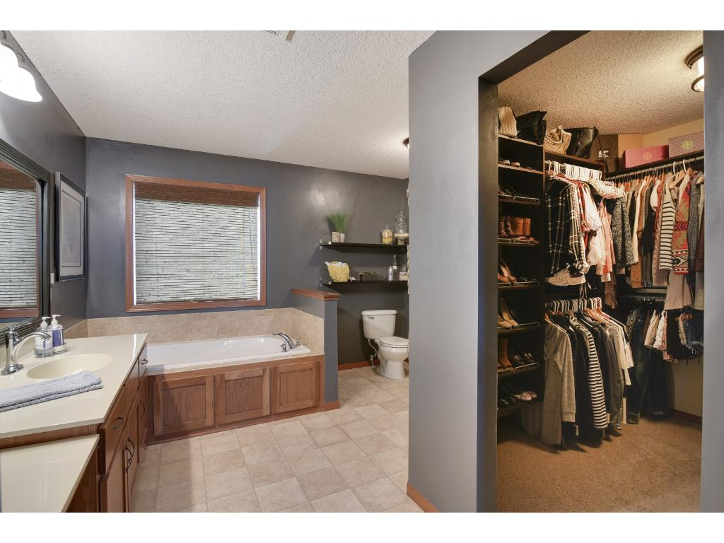 Master bathroom with soaking tub and walk-in closet.
