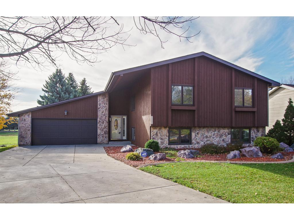 Rich cedar front with easy care 3 sides vinyl siding.  Professionally landscaped.