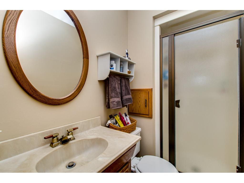 Private 3/4 owner's bath with new ceramic tile flooring.