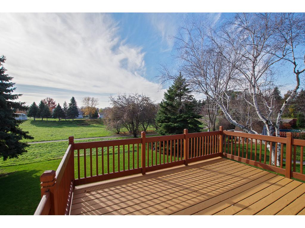 Large deck overlooking park and walking trail.
