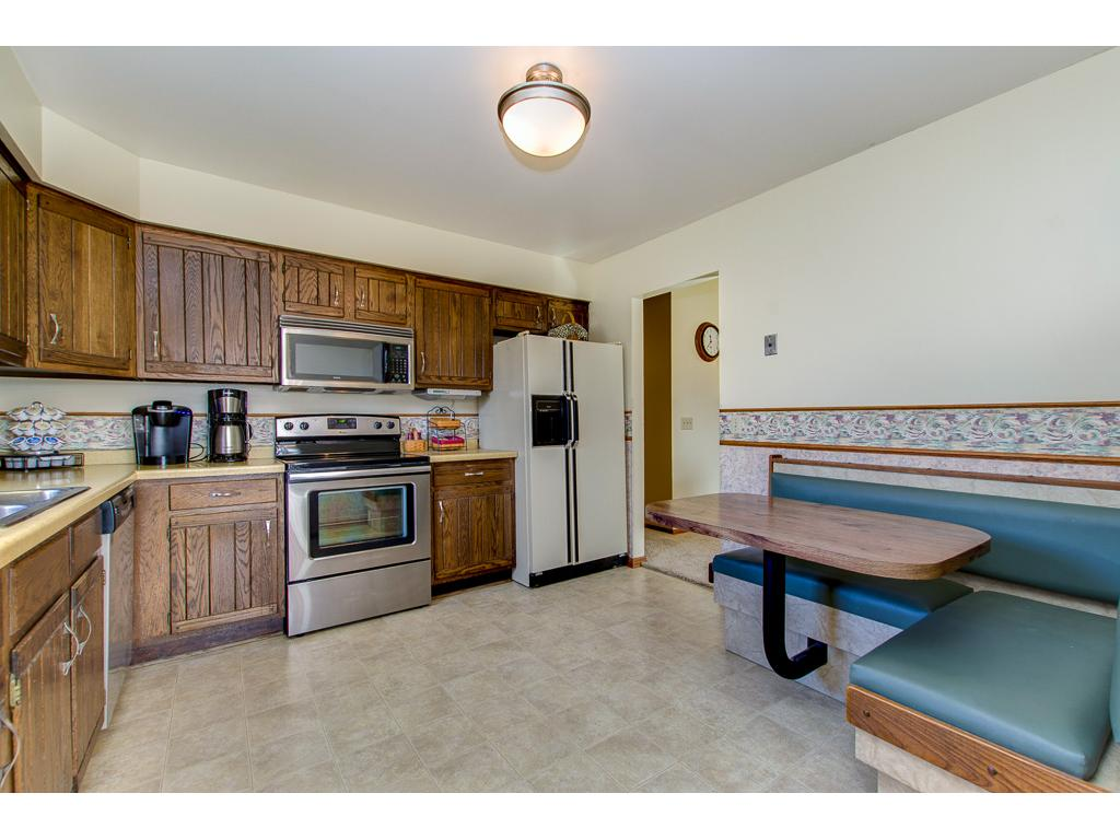 Convenient built-in banquette makes a great breakfast spot.