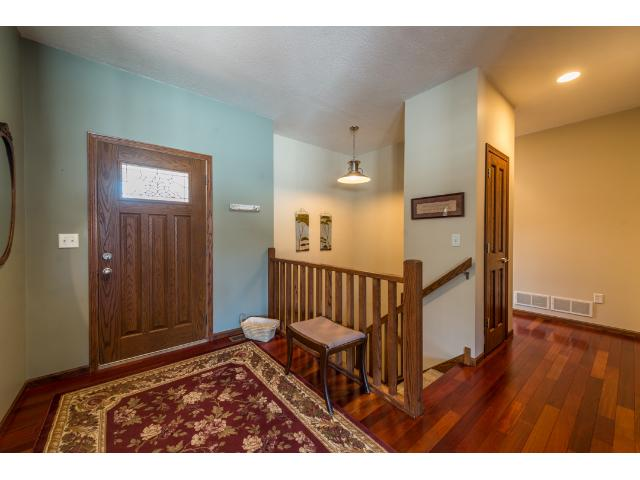 large 9 foot ceilings and grand entrance to the house. Cherry hardwood flooring
