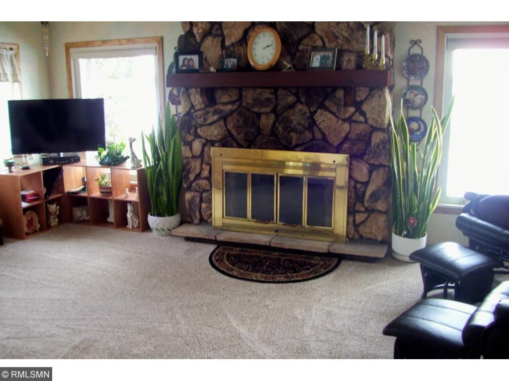 Gas fireplace in living room, new carpet and sub flooring! Newly sprayed ceilings.