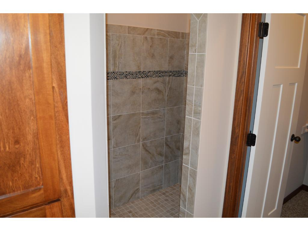 Walk-in shower in master bath with beautiful tile work
