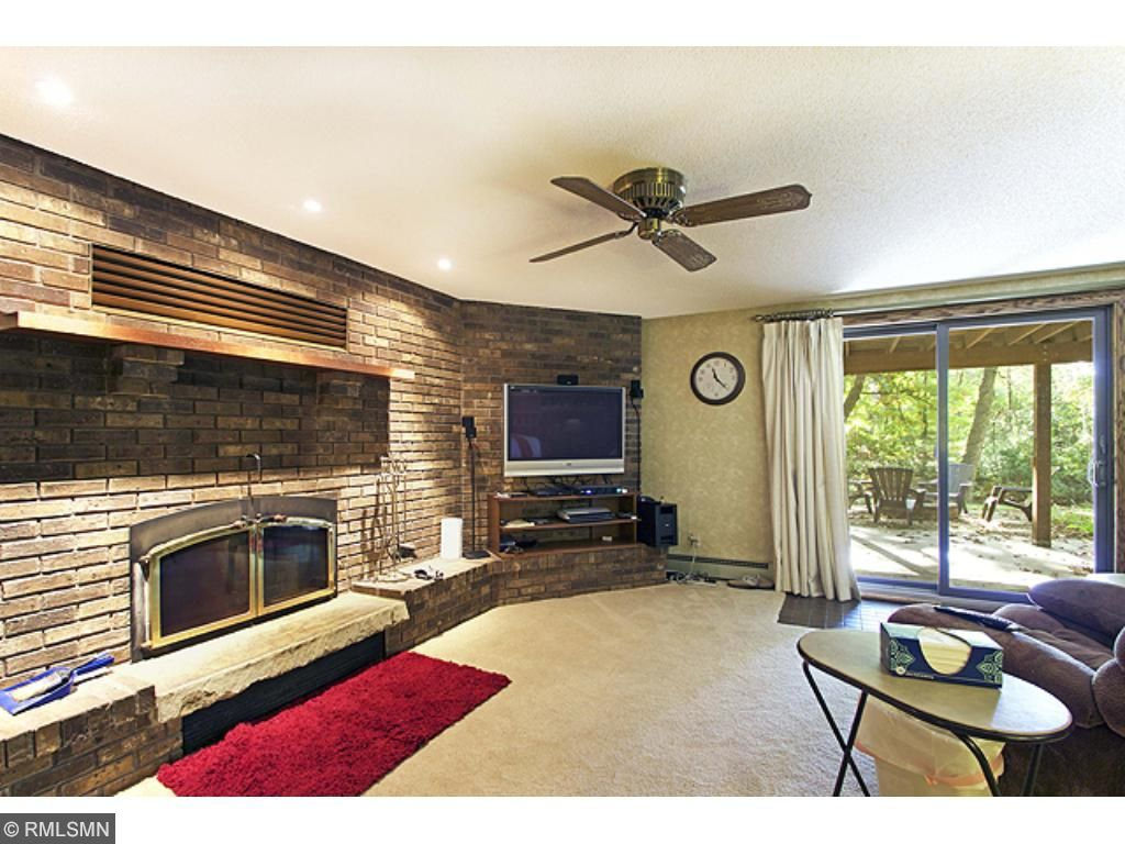 Lower level: Beautiful, wood burning, brick fireplace with new chimney/ firebox and newer carpeting.