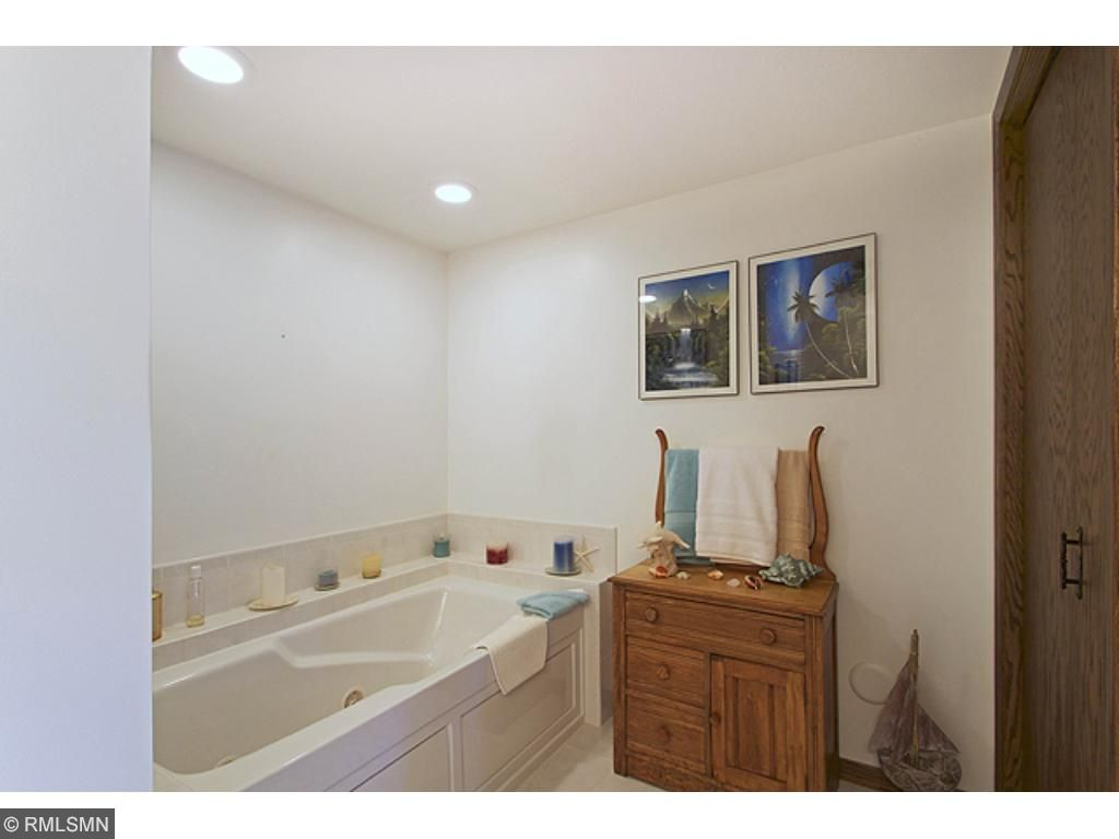 Lower level full bath with jaccuzzi tub. Right of the lower level bedroom. Makes for a great, guest suite or a lower level Master bedroom.
