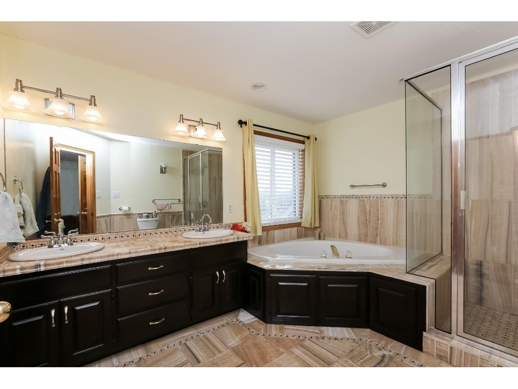 Master bath with jacuzzi bathtub and double vanity.  Beautiful tile as well!
