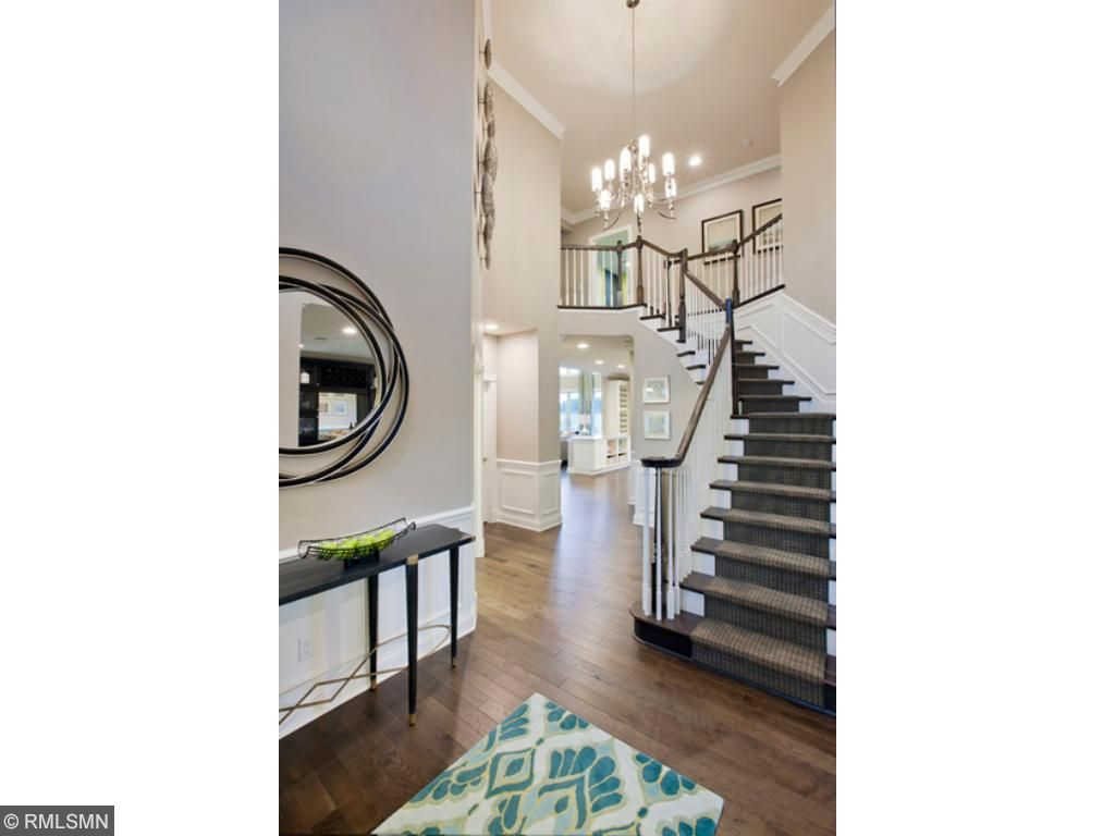 Two story foyer with turn staircase