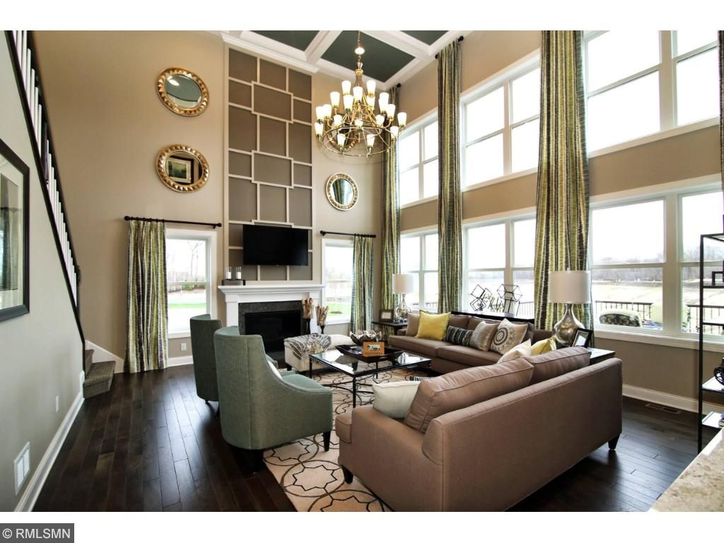 Two story expanded family room with fireplace