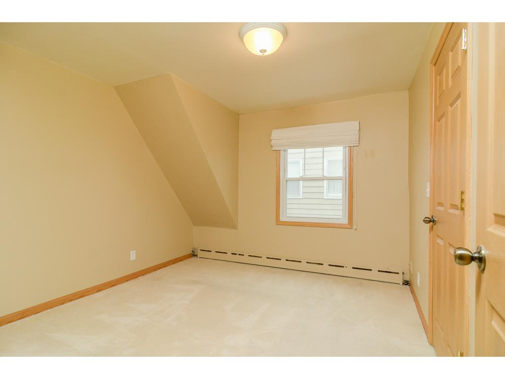 Third bedroom, in the upper level is roomy and has a large closet