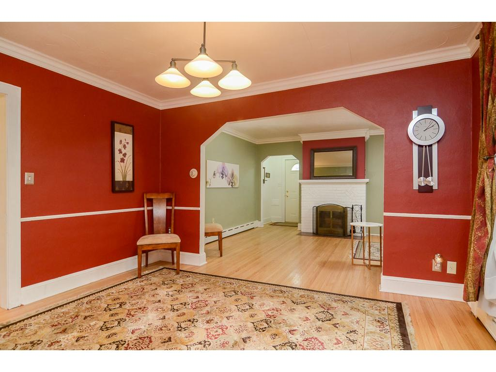 Hardwood floors throughout the main level, including in the formal dining room.
