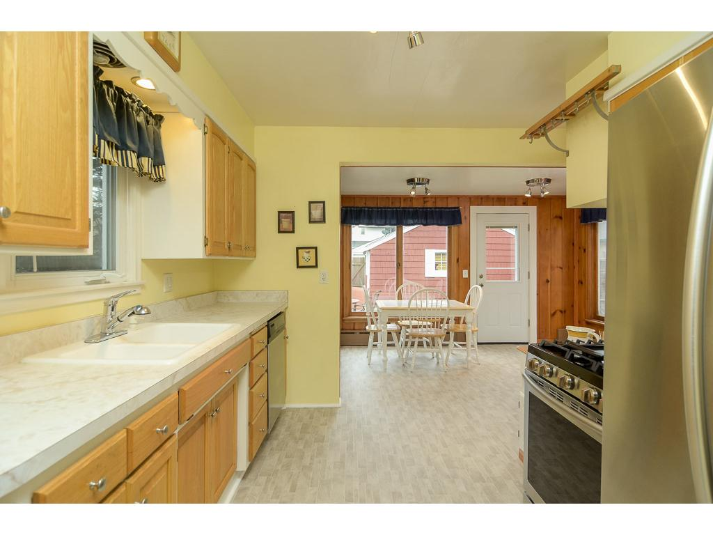 Oversized kitchen features large, sunny informal dining room.