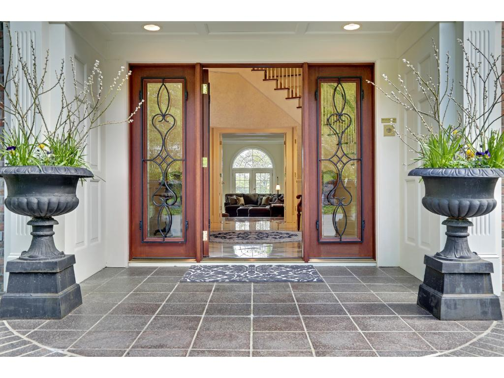 Stunning front and back foyers with sweeping staircases and magnificent chandeliers.
