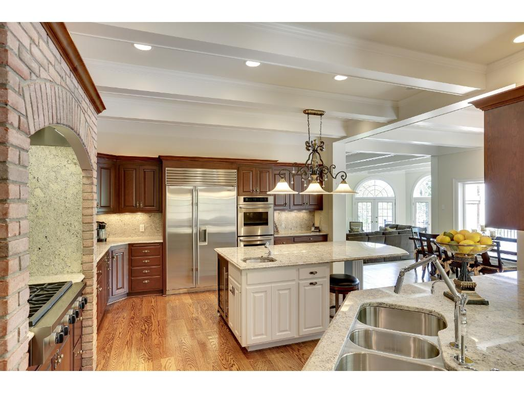 Kitchen made for cooking gourmet meals with multiple prep areas. Butler's pantry with prep sink, built in cabinets and beautiful tall windows. Conveniently located between kitchen and formal dining room.