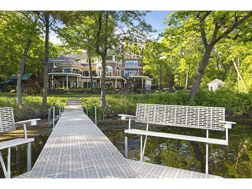 From the home, it's a short walk to your own private dock and lakeshore. Multiple built in benches... a wonderful way to enjoy a Minnesota summer evening!