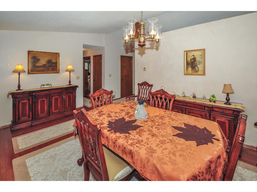 The formal dining room located just off the kitchen is the perfect setting for rich conversation over a meal.