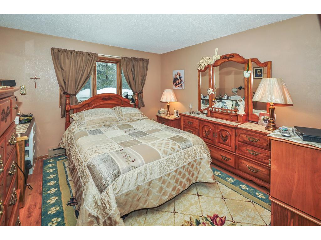 Upstairs, the master bedroom has ample room for any size bedroom set.