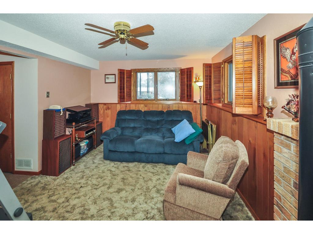 Sitting down for a game, or cozying up for a fire. This lower level family room can accommodate.